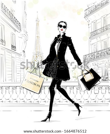 Hand drawn beautiful young woman with bags. Fashion look. Stylish girl in fashion clothes with Paris street background. Woman in black coat. Sketch. Fashion illustration.