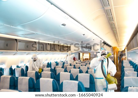 Covid-19 disease prevention. Aircraft interior cabin deep cleaning for coronavirus. Royalty-Free Stock Photo #1665040924
