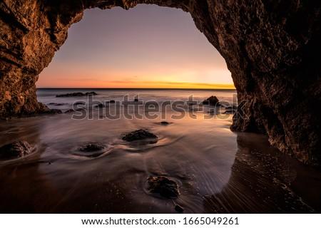 California  sea cave sunset along the coast