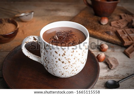 Cup of hot chocolate on wooden table Royalty-Free Stock Photo #1665115558