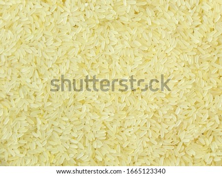 Rice. Background of uncooked rice. Pic top view close -up. The preparation of pilaf. Copy space.