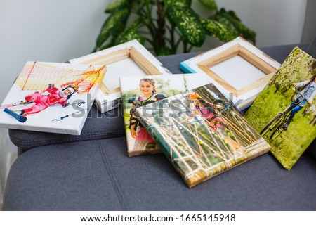 Photography canvas prints. Stacked colorful photos with gallery wrapping method of canvas stretching on stretcher bar, lateral side Royalty-Free Stock Photo #1665145948