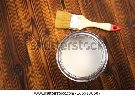 House renovation, paint can on the old wooden background with copy space #1665190687
