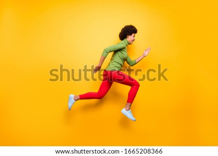 Full length body size profile side view of nice attractive lovely cheerful cheery wavy-haired girl jumping running active life isolated over bright vivid shine vibrant yellow color background #1665208366