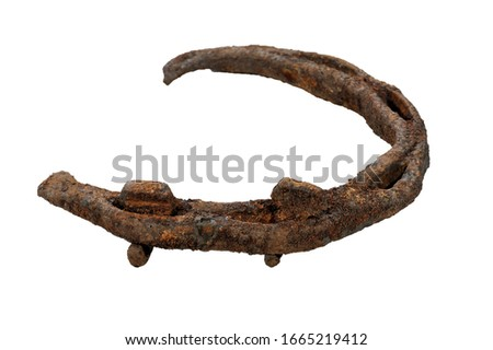 Old rusty horseshoe isolated on white #1665219412