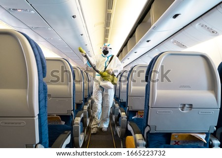 Covid-19 disease prevention. Aircraft interior cabin deep cleaning for coronavirus. #1665223732