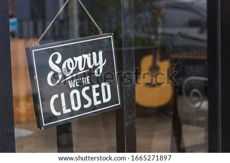 Sorry we're closed sign. grunge image hanging in cafe front #1665271897