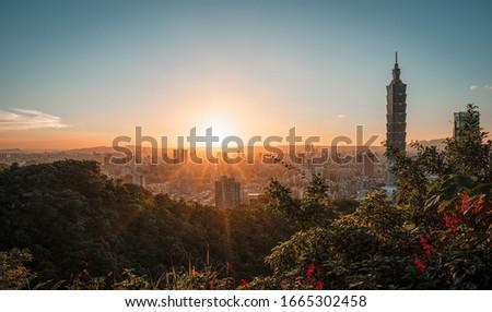 Stunning sunset view of Taipei with Taipei 101 tower, north of Taiwan #1665302458