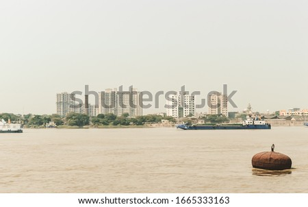 Landscape view of Kolkata (Bengali Kalikata) city capital West Bengal, on east bank Hooghly River (main channel Ganges / Ganga) Bay of Bengal. Calcutta is a city of land, river, water and sea.  #1665333163