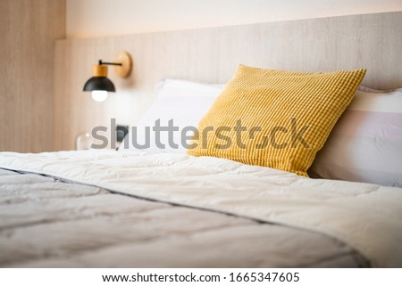 Chic and luxury yellow pillow and white blanket on white oak wooden single bed with bedside hanging lamp in cozy bedroom, Comfy and tasteful bedroom design for everyday living of condo, home. #1665347605