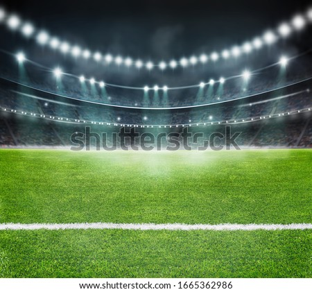 green field in soccer stadium. ready for game Royalty-Free Stock Photo #1665362986