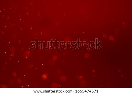 Red glitter vintage lights background. White bokeh on red background.