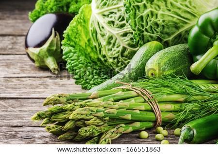 Fresh green vegetables on wooden table  #166551863