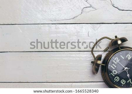 alarm 7 o' Clock on wood table