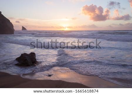 Sunset at rocky Atlantic ocean coastline of Adraga beach, Portugal #1665618874