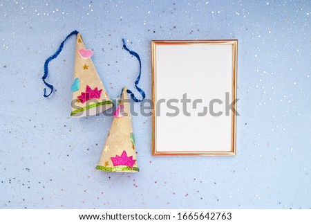 Festive background. Gold photo frame, shallow shiny confetti. Place for text, blue background