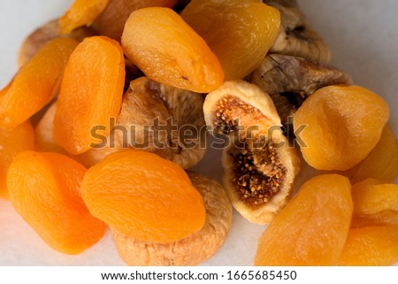 Dried figs and apricots on white background  #1665685450