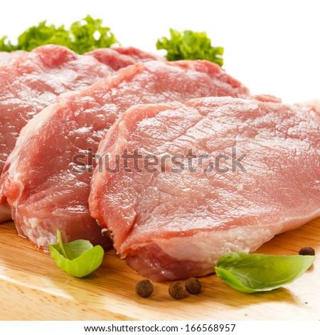 Fresh raw pork chops on white background  #166568957