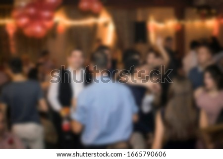 Birthday party, night out or New Year celebration. Blurred image for background use.