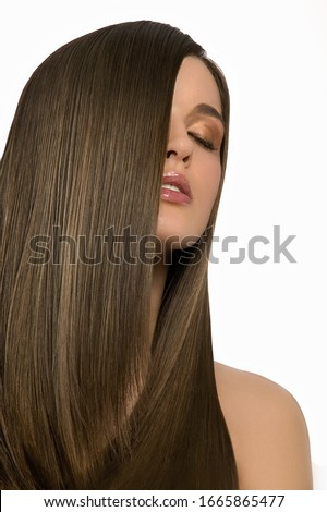 Studio shot of woman with hair in face and eyes closed #1665865477