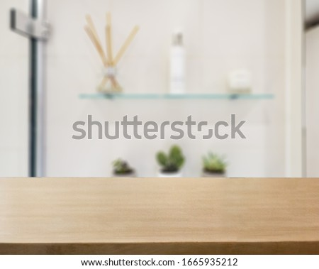 Table Top And Blur Bathroom Of The Background #1665935212