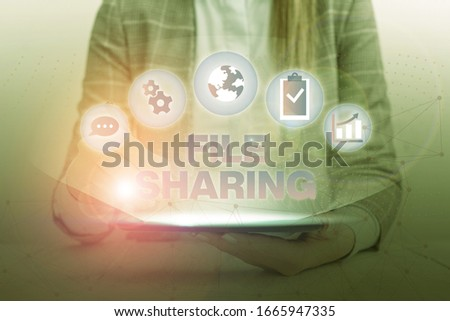 Conceptual hand writing showing File Sharing. Business photo text transmit files from one computer to another over a network. #1665947335