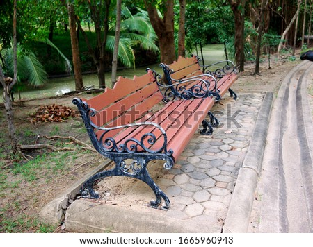 Two wooden sofa beside of the pond in Queen Sirikit Park. #1665960943