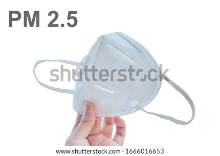 hand holding KN95 or N95 mask for protect PM 2.5 on white background.hand holding N95 mask with PM2.5 word. #1666016653
