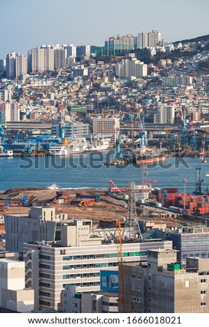 Busan, South Korea - March 22, 2018: Vertical seaside cityscape of Busan, port aerial view #1666018021