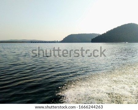 picture of dam from the back of boat, water drops due to speed of boat may look like noise but actually these are the beauty of the pic.
