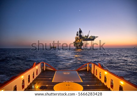 Supply vessel going for cargo operations for oil production plant. Dynamic positioning vessel going for cargo operations for jack up rig.  Royalty-Free Stock Photo #1666283428