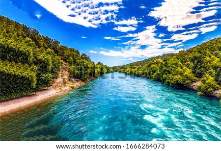 Forest blue river water landscape. Blue river water flow in forest. Forest river landscape. River in forest #1666284073