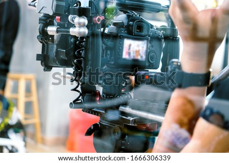 Film industry. Filming with professional camera background #1666306339