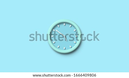 Aqua wall clock on the wall. Minimalist flat lay image of plastic wall clock over blue turquiose background with copy space and central composition.Wall clock icon #1666409806