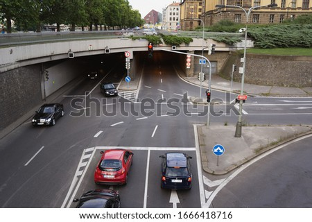 Prague, Czech Republic / Czechia - June 17, 2017: Cars, vehicles and automobiles are one the road, crossroad and intersection. Transportation in the city and town. Partly motion blur. #1666418716