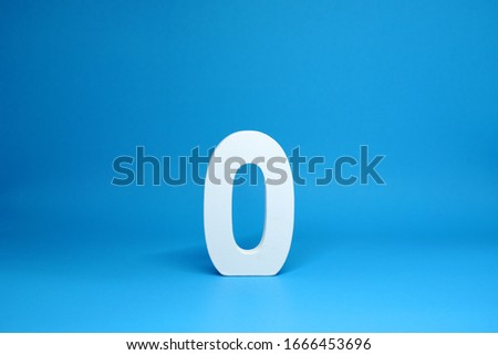 Non or Zero ( 0 ) white wooden  Isolated Blue Background with Copy Space - New promotion 0% Percentage  Business finance Concept #1666453696