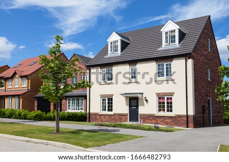 New and modern english houses Royalty-Free Stock Photo #1666482793