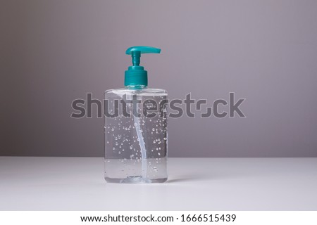 Bottle of hand sanitizer, antimicrobial liquid gel, germ prevention or antibacterial hygiene #1666515439