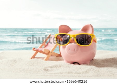 Piggy bank resting on vacation. Saving money, travel concept