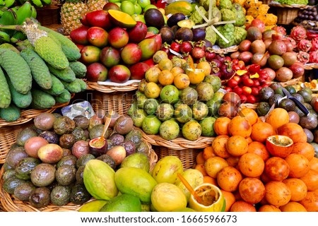 Kinds of tropical fruits displayed on stall of the Funchal market, Madeira, Portugal #1666596673