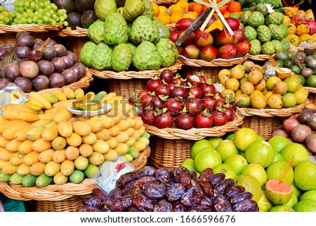 Kinds of tropical fruits displayed on stall of the Funchal market, Madeira, Portugal #1666596676