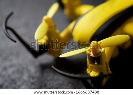 Yellow drone on a black table. #1666637488