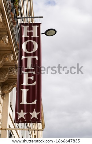 Hotel sign two stars street flag logo hanging