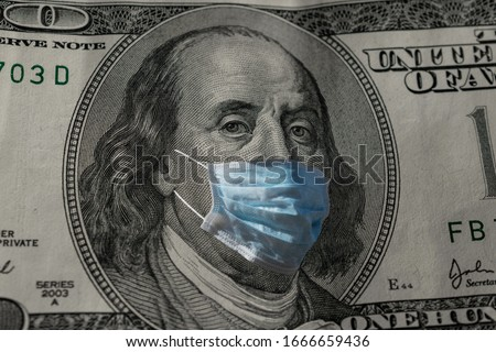 Concept for quarantine and recession. 100 dollar banknote with a face mask against CoV infection. Global economy hit by corona virus outbreak and pandemic Royalty-Free Stock Photo #1666659436