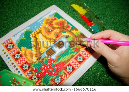 Diamond mosaic - modern needlework. DIY kit for making a shining picture of beads.