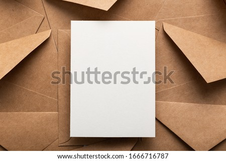Blank white card with kraft brown paper envelope template mock up Royalty-Free Stock Photo #1666716787
