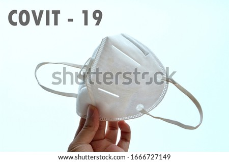 close up KN95 or N95 mask for protection pm 2.5 and corona virus(COVIT-19).Anti pollution mask.air face mask with covit-19 word on white background. #1666727149