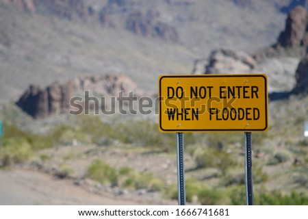 Do Not Enter When Flooded Sign on Route 66 in Mohave County, Arizona USA