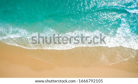 Top view aerial image from drone of an stunning beautiful sea landscape beach with turquoise water with copy space for your text.Beautiful Sand beach with turquoise water,aerial UAV drone shot #1666792105