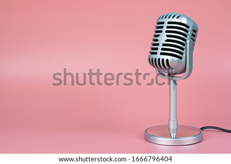 Retro microphone with copy space on pink background #1666796404